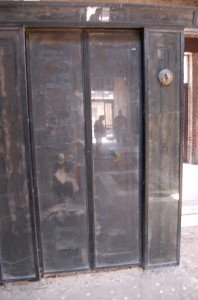 Original wooden screen door in the House of the Grand Portal, Herculaneum. The ash from the pyroclastic surges protected organic objects from incineration, instead carbonising and preserving them. Photograph copyright  of Natasha Sheldon