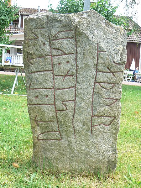 Reading the runes. Rune stones are found in parts of Northern Europe including Sweden, Norway and Scotland. Image by Skvattram.